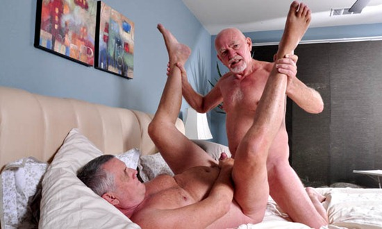Senior men having sex together